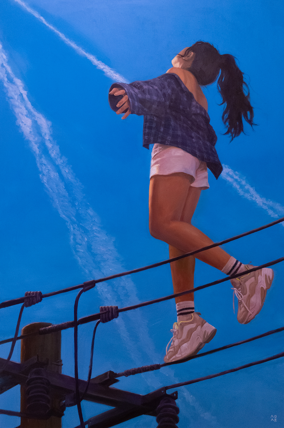 A girl tiptoeing on a cable from a electric pole